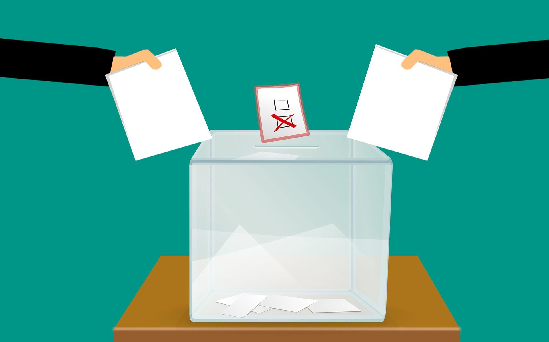 Grafik zur Kommunalwahl 2021, Einwurf von Wahlunterlagen in die Wahlurne